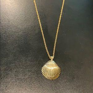 Gold tone she'll pendant